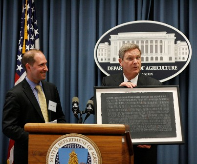"Secretary Vilsack receives an ""Omer Counter"" piece of artwork on behalf of the Department of Agriculture."
