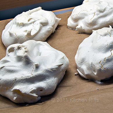Baked meringues on brown paper