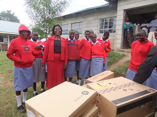 Enoosaen Girls Secondary receiving the computers. The deputy head teacher is pretty excited herself.