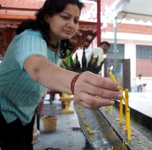 Praying at the Standing Buddha, Bangkok 2011 9