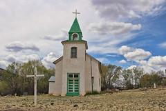 La Iglesia de San Patricio (Helen Orozco) Tags: newmexico cross catholicchurch stpatrick stucco 1884 sanpatricio lincolncounty landofenchantment hondovalley