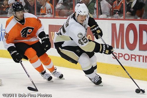 Arron Asham #45 of the Pittsburgh Peguins carries the puck while being pursued by Ville Leino #22 of the Philadelphia Flyers on March 24, 2011 at the Wells Fargo Center in Philadelphia, PA. The Pengui