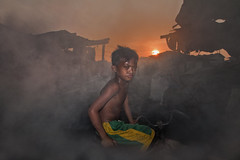 Ulingan, Tondo, 5.38pm  - Children of the Smoke (Mio Cade) Tags: boy sunset hot work kid factory child smoke philippines business charcoal pollution manila labour choke tondo ulingan