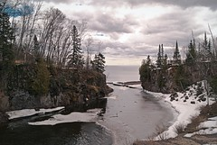 Temperance Enters Lake Superior (Doug Wallick) Tags: park trees lake snow ice water minnesota clouds river rocks state north superior evergreen shore schroeder picnik lightroom temperance highway61 a230