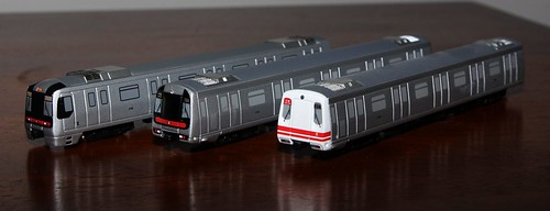 Diecast models of MTR EMUs: K-Stock, refurbished M-Train, and original M-Train variants