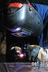Welder (Netfalls) Tags: light man metal work factory mask steel welding weld labor flash helmet sparkle worker laborer spark protection welded skill manufacture welder manufacturing trained skilled laboring
