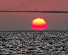 See you tomorrow (n.pantazis) Tags: bridge sunset sea sky sun streetlamps orb explore cables sunspot sunspots 200mm rioantirrio dal50200