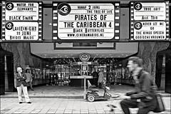 cinema (heavenuphere) Tags: street bw cinema man netherlands blurry rotterdam waiting europe cyclist nederland vo cinerama fvs zuidholland southholland filmtheater fotovakschool 1750mm vakopleiding noididntseeanyofthefilms
