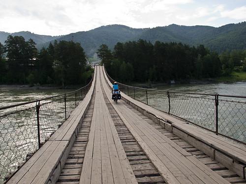 Emma cycling over Aya bridge