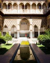 The Royal Alczar (dawolf-) Tags: alcazar spain royal palace oriental travel sevilla andalusia summer vacation roadtrip garden pond pool arc ancient red dress tourist reflection gameofthrones amazingrace
