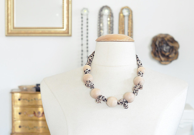 wood bead necklace with leopard and gold accents