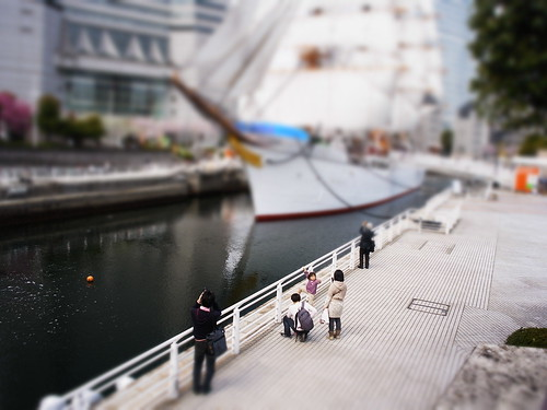 miniature looking at sailing boat