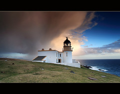 Rainshowers Stoer Lighthouse (angus clyne) Tags: blue light red cliff cloud sun lighthouse white mountain storm west fall grass rain rock stone dark point island coast scotland boat ross highlands high paint time tide north picture deep scottish wave shire splash