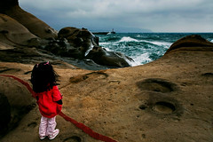 behind the line (filchist) Tags: lighthouse green water girl clouds pier waves stones taiwan yehliu      geopark girlinred  taiwanyehliugeopark redlinemnature