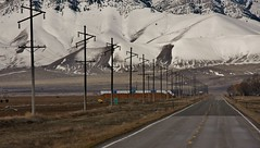 Backroads of Idaho..out the windshield. (DJ MacTrucker) Tags: snow mountains highway flickr power idaho powerlines covered hay bales irrigation tarp cratersofthemoon yellowline hwy22 lethflourtosanfran