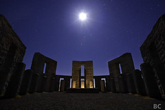 Stonehenge Moon (Ben Canales) Tags: longexposure blue light orange moon stars star glow pillar altar stonehenge starry sacrifice maryhillstonehenge bencanales thestartrail