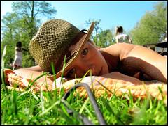 day1865 mon25apr2011 (a.pic.a.day) Tags: summer sun selfportrait green girl grass hat sunshine amsterdam eyes groen bikini zomer suntan gras browneyes vondelpark paperhat tanning suntanning summerhat zonneschijn zonnen