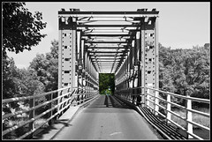 Just another bridge over troubled water (EXPLORE) (Bert Kaufmann) Tags: bridge holland netherlands canal blackwhite iron zwartwit nederland pont brug brcke paysbas twente olanda niederlande selectivecolor zutphen staal twentekanaal almen stalenbrug selectievekleuring