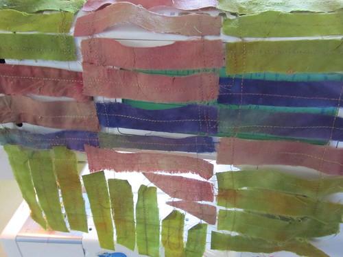 anatsui fabric strips draped