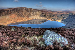 Lough Tay (Mick H 51) Tags: morning ireland lake reflection stone canon landscape eos scenery lough sigma images tay getty wicklow 1020 springtime gettyimages loughtay 450d
