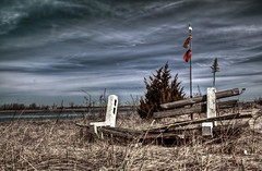 Landmark (Jack Wassell) Tags: abandoned beach broken bench island flag bluesky landmark vandalism ghosttown destroyed hdr pleasurebeach