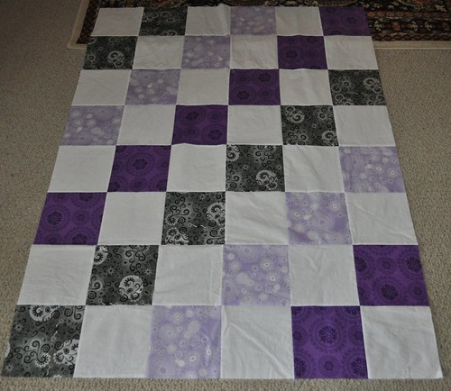 gray and purple quilt top