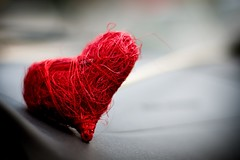 love, dashed (helen sotiriadis) Tags: red macro love wool car closeup canon grey dof heart bokeh gray valentine depthoffield yarn dashboard rough canonef50mmf14usm canoneos40d
