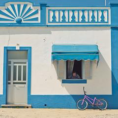 The Case of the Missing Saddle (Allard Schager) Tags: door pink blue house portugal window bike bicycle lady faro town spring nikon bmx blauw village candid decoration santaluzia streetscene plaster apr