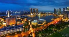 After the rain. (Reggie Wan) Tags: city urban building tourism skyline architecture evening singapore asia southeastasia cityscape aerialview esplanade bluehour marinabay marinacentre moderncity asiancity marinabaysands sonya700 sonyalpha700 reggiewan yoursingapore gettyimagessingaporeq1