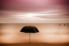 Umbrella in the sea (!.Keesssss.!) Tags: sunset sea nature netherlands silhouette horizontal umbrella outdoors photography tranquility zeeland nopeople scenics gettyimages absence colorimage rightsmanaged romanticsky theflickrcollection keessmans 171ksgetty