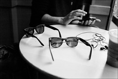 wayfarers (gorbot.) Tags: blackandwhite bw sunglasses cafe raw glasgow wayfarer rayban dng f17 leicam8 digitalrangefinder ltmmount voigtlander28mmultronf19