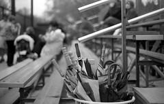 Just In Case (Fogel's Focus) Tags: 50mm baseball f14 olympus chrome bleachers rodinal umbrellas zuiko wilmette 1100 acros standdevelopment agfarodinal om1n 45min roemerpark film:iso=100 legacypro100 developer:brand=agfa developer:name=agfarodinal film:brand=freestylearista freestylearistalegacypro film:name=freestylearistalegacypro100 filmdev:recipe=6345
