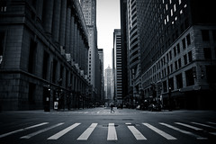 walk alone (John J Curtis) Tags: street blackandwhite chicago lasalle crosswalk boardoftrade notarealphotographer johnjcurtis