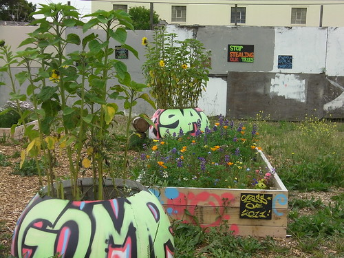 The mural accompanies Gompers Garden, a school-tended vegetable garden of raised beds on the greenway.
