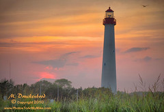 Cape May NJ Lighthouse at sundown (PhotosToArtByMike) Tags: sunset lighthouse seascape landscape seaside newjersey sundown scenic nj capemay capemaynj capemaynewjersey landscapephotograph