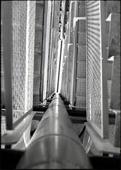 Metal on Metal (Salva G.) Tags: barcelona bw white black byn film blanco metal analog pen 35mm stair y kodak tmax negro olympus bn escalera negative 400 frame half scanned ft pelicula asa arenas halfframe f18 35 blanc negre analogica analogic escales 38mm analogico fzuiko pellicula