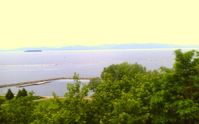 Photograph of Lake Champlain in Burlington, Vermont with the Adirondack Mountains in the distance.