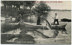 This Is No Dream—How We Do Things at Ovid, Mich. (Alan Mays) Tags: ephemera postcards exaggerations ovid mi michigan fish antique old vintage humor humorous funny asjohnsonjr postcardpublishers 1913 1910s fishing boats fishermen men talltalepostcards animals upd dreams paper printed talltales oversized giant fantasy mammoth huge comic johnson alfredstanleyjohnsonjr alfredstanleyjohnson stanleyjohnson waupun wi wisc wisconsin howwedothings mich