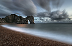 Durdle Door (peterspencer49) Tags: longexposure greatbritain sunset england sky seascape southwest clouds coast europe unitedkingdom dusk steps dorset moonlight coastline seaview coastalpath westcountry durdle southwestcoast durdledoor stonearch jurassiccoast rockarch dorsetcoast southwestcoastalpath woldheritagesite stunningview seascene oceanveiw limestonearch 5dmkll peterspencer stunningseascape