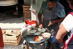 And then, this woman set up with tlacoyos (Boots in the Oven) Tags: travel woman mexico stand mexicocity df griddle northamerica streetfood masa tlacoyo