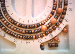 bead-board-with-wooden-necklace-and-pearls (Authentic Arts) Tags: wood wisconsin necklace crafts jewelry etsy beading asymetric beadednecklace beadedjewelry jewelrydesigner woodennecklace copperpearls jewelrymakingtutorial beadingtutorial howtomakeabeadednecklace