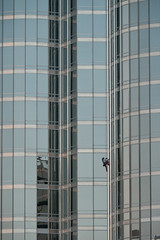 Alain Robert starting his way up the world's tallest building. Took him just over six hours to conquer.