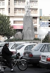 ferdowsi square, tehran, iran (mooon2) Tags: monument car bike canon square iran helmet tehran ایران motocycle ferdowsi