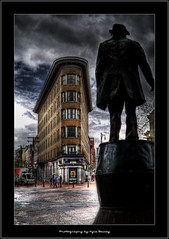 Silhouette of Gassy Jack in Gastown, Vancouver BC - HDR (Kyle Bailey - Da Big Cheeze) Tags: street sculpture building brick art statue architecture vancouver canon gastown waterstreet vancouverbc hdr highdynamicrange hdri gassyjack hoteleurope angelocaloribuilding canon7d kylebailey rookiephoto dabigcheeze wwwrookiephotocom