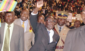 PRESIDENT Mugabe waves to children who attended yesterday's independence party he hosted at the City Sports Centre in Harare. On his right is Youth Development, Indegenisation and Empowerment Minister Saviour  Kasukuwere. by Pan-African News Wire File Photos
