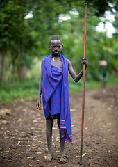 Menit boy with stick - Ethiopia (Eric Lafforgue) Tags: africa boy people colour childhood vertical horizontal youth outside outdoors person kid child market fulllength jeunesse innocence omovalley stick marketplace ethiopia enfant tum baton naivete personne humanbeing marche contemplation afrique bluescarf dehors omo eastafrica garcon enfance abyssinia ethiopie exterieur lookingatcamera traditionalclothes toum enpied 0787 abyssinie vueexterieure coloredpicture photocouleur menit photoenpied afriquedelest etrehumain habittraditionnel meinit valleedelomo regardantlobjectif peoplesoftheomovalley peuplesdelavalleedelomo colouredpicture habittraditionnels peuplemenit menitpeople tribudesmenits menittribe meinitpeople meinittribe اتیوپی