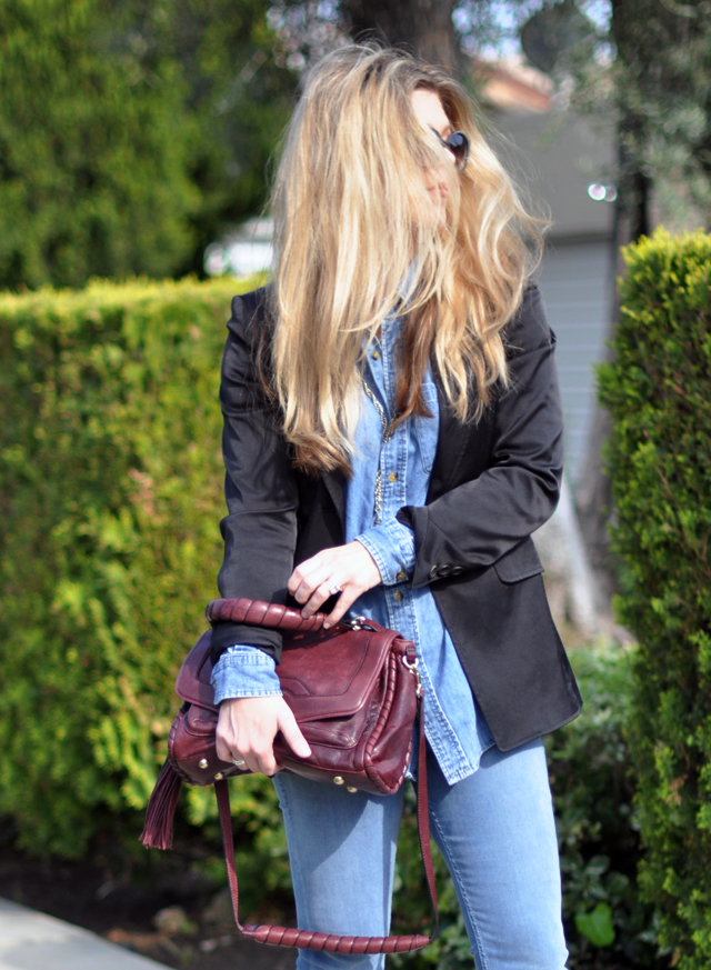 big hair + denim on denim look + blazer and jeans+ burgundy leather bag with tassel