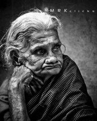 ....../A long Wait..... (MRK Clicks) Tags: old bw white beautiful wall lady nikon indian streetphotography chennai cwc mrk mylapore 55200mm kalki d40  silksaree  chennaiweekendclickers waitingforlong mrkclicks bestof2011 10best2011