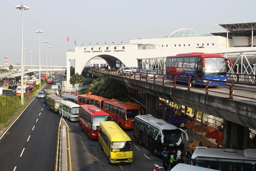 Traffic jam made up of casino shuttle buses, outside the Macau ferry terminal