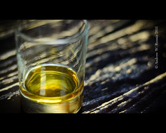 Bunnahabhain (andrewrennie) Tags: glass yellow table 50mm nikon bokeh grain alcohol whisky liquid tabletop tumbler d90 bunnahabhain primelens nikond90 andrewrennie andrewrenniephotography